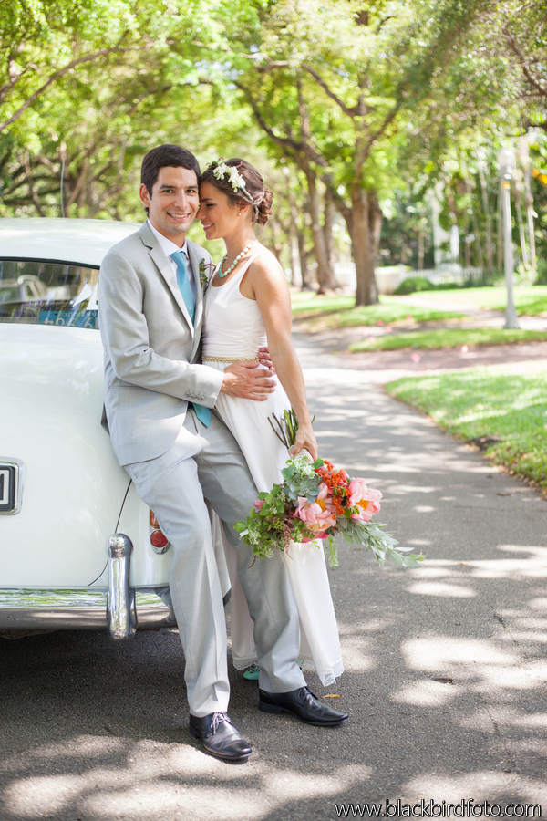 Bride and Groom with Vintage Car by Millennium Transportation